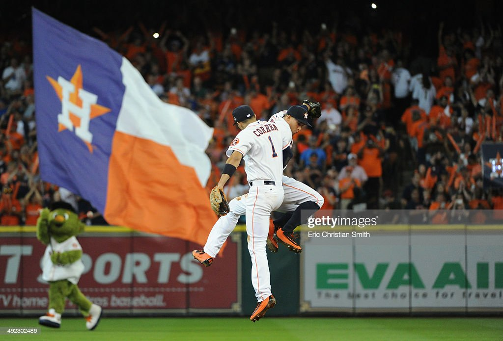 Carlos Correa #1 of the Houston Astros celebrates with George Springer #4 of the Houston Astros after the Houston Astros defeat the Kansas City Royals in game three of the American League Division Series at Minute Maid Park on October 11, 2015 in Houston, Texas. The Houston Astros defeated the Kansas City Royals with a score of 4 to 2.