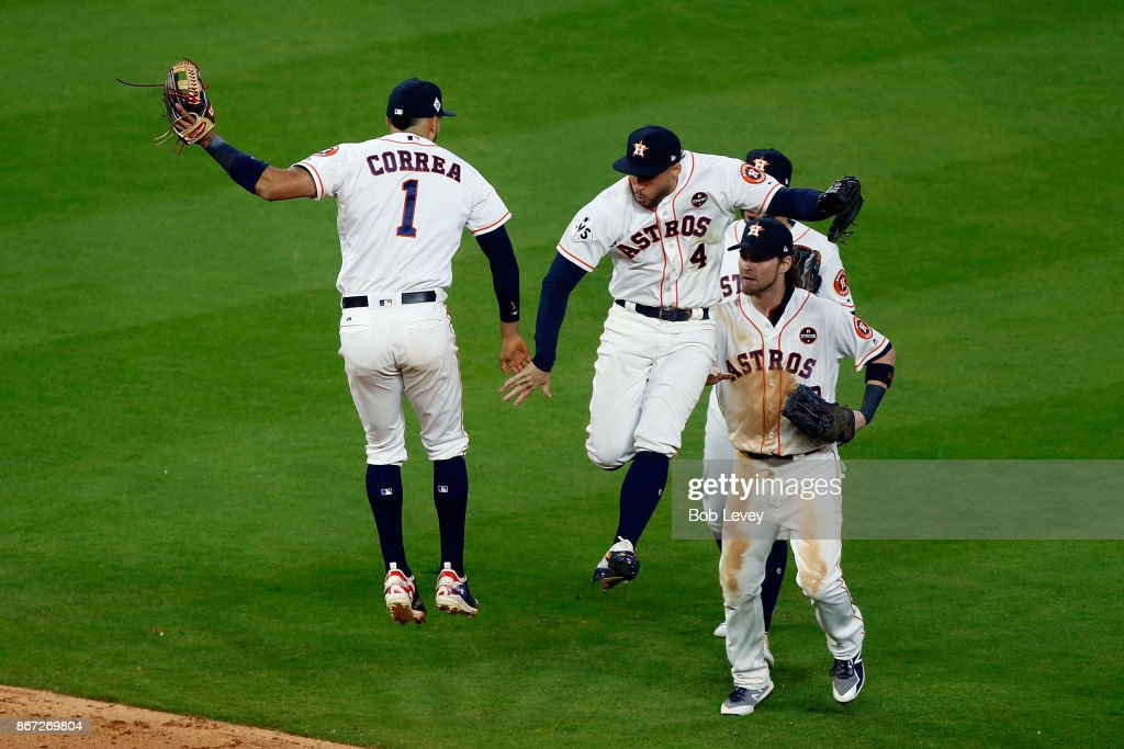 Carlos Correa #1 of the Houston Astros celebrates with George Springer #4 after defeating the Los Angeles Dodgers in game three of the 2017 World Series at Minute Maid Park on October 27, 2017 in Houston, Texas. The Astros defeated the Dodgers 5-3.