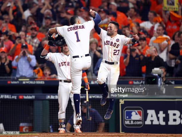 Carlos Correa of the Houston Astros celebrates with Jose Altuve after hitting a tworun home run in the seventh inning of Game 5 of the 2017 World...