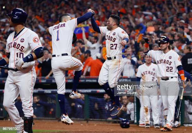 Carlos Correa of the Houston Astros celebrates with Jose Altuve after hitting a tworun home run during the seventh inning against the Los Angeles...