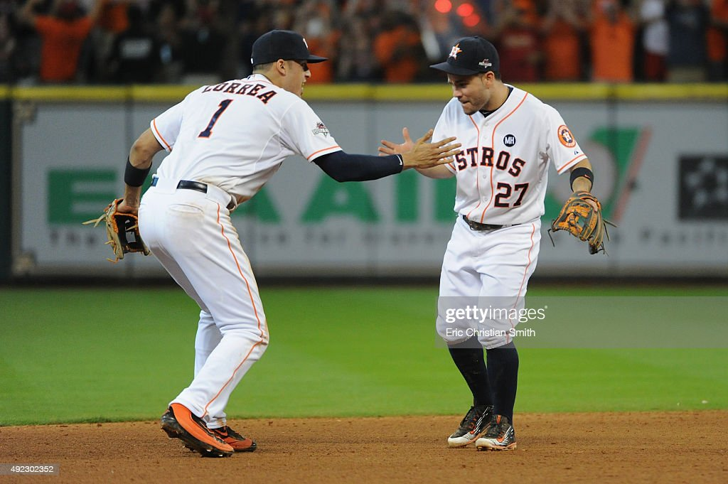 Carlos Correa #1 of the Houston Astros celebrates with Jose Altuve #27 of the Houston Astros after the Houston Astros defeat the Kansas City Royals in game three of the American League Division Series at Minute Maid Park on October 11, 2015 in Houston, Texas. The Houston Astros defeated the Kansas City Royals with a score of 4 to 2.