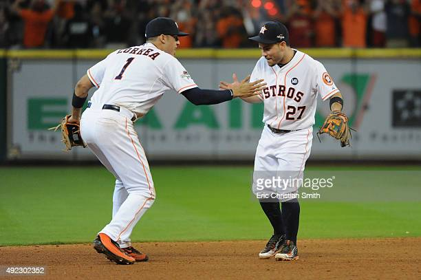 Carlos Correa of the Houston Astros celebrates with Jose Altuve of the Houston Astros after the Houston Astros defeat the Kansas City Royals in game...