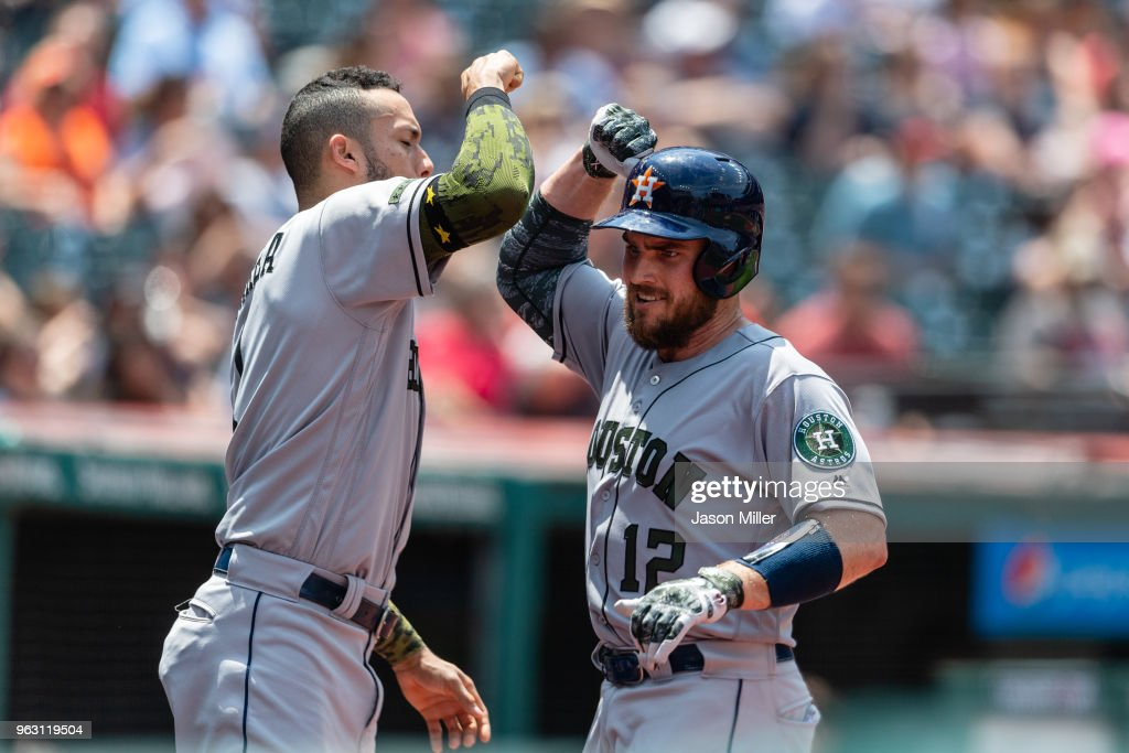 Carlos Correa #1 of the Houston Astros celebrates with Max Stassi #12 after Stassi's solo home run during the second inning against the Cleveland Indians at Progressive Field on May 27, 2018 in Cleveland, Ohio.