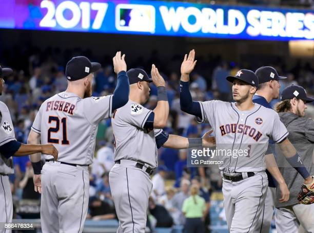 Carlos Correa of the Houston Astros celebrates with teammates after winning Game 2 of the 2017 World Series against the Los Angeles Dodgers at Dodger...