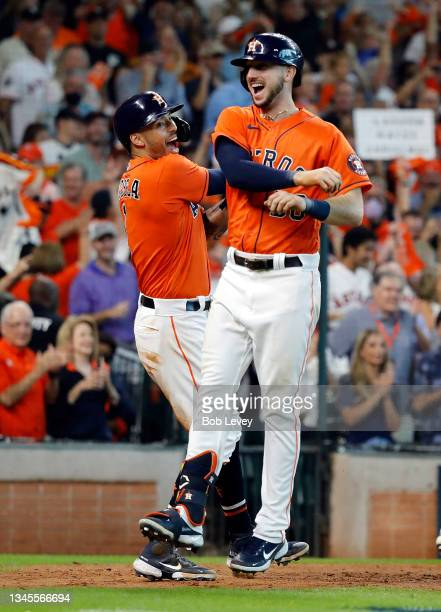 Carlos Correa of the Houston Astros congratulates Kyle Tucker after Tucker hit a home run during the 7th inning of Game 2 of the American League...