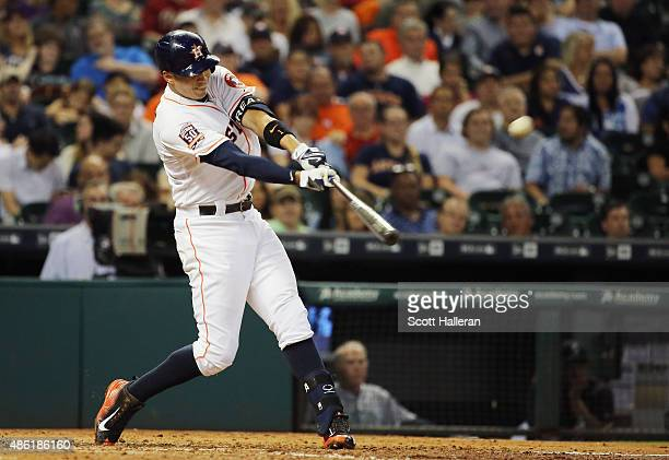 Carlos Correa of the Houston Astros connects on a double in the third inning of their game against the Seattle Mariners at Minute Maid Park on...