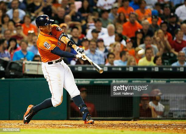 Carlos Correa of the Houston Astros connects on a solo home run in the fifth inning during their game against the Arizona Diamondbacks at Minute Maid...