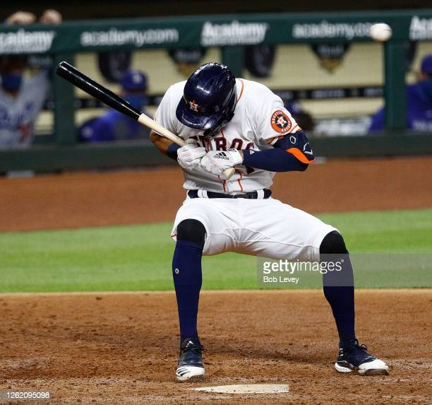 Carlos Correa of the Houston Astros ducks from a high pitch by Joe Kelly of the Los Angeles Dodgers in the sixth inning at Minute Maid Park on July...
