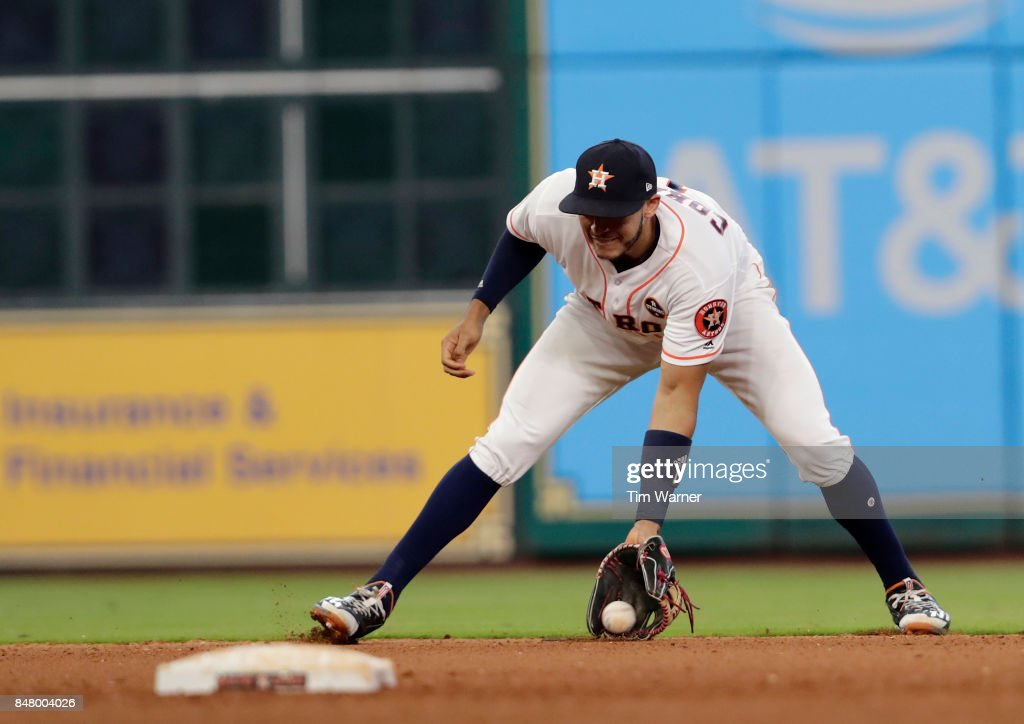 Carlos Correa #1 of the Houston Astros fields a ground ball in the seventh inning against the Seattle Mariners at Minute Maid Park on September 16, 2017 in Houston, Texas.