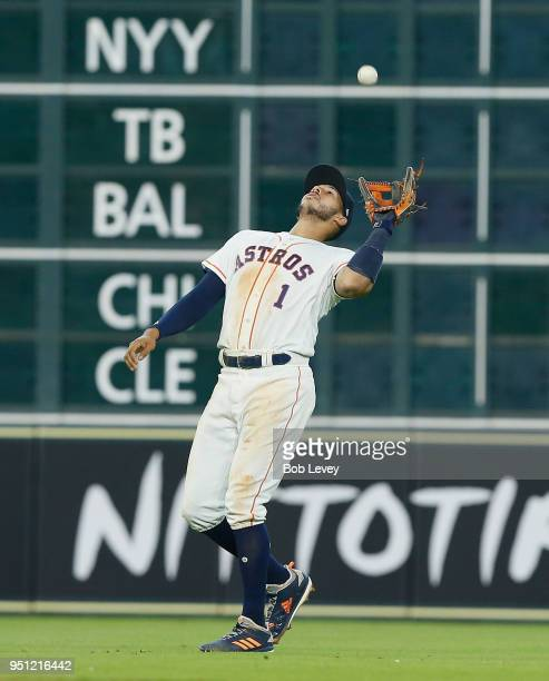 Carlos Correa of the Houston Astros fields a pop fly off the bat of Albert Pujols of the Los Angeles Angels of Anaheim in the fifth inning at Minute...