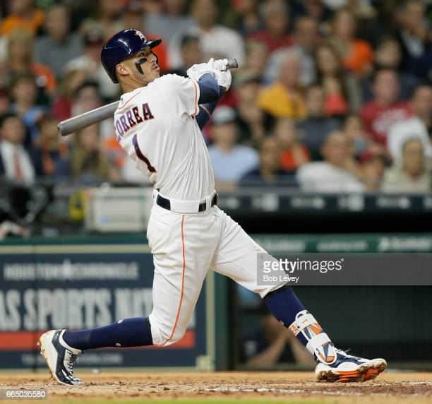 Carlos Correa of the Houston Astros flies out ot right field in the third inning against the Seattle Mariners at Minute Maid Park on April 5 2017 in...