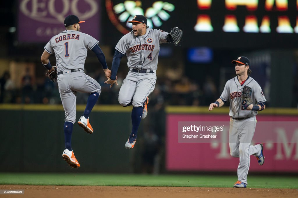 Carlos Correa #1 of the Houston Astros, George Springer #4 of the Houston Astros and Josh Reddick #22 of the Houston Astros celebrate after a game against the Seattle Mariners at Safeco Field on September 6, 2017 in Seattle, Washington. The Astros won 5-3.