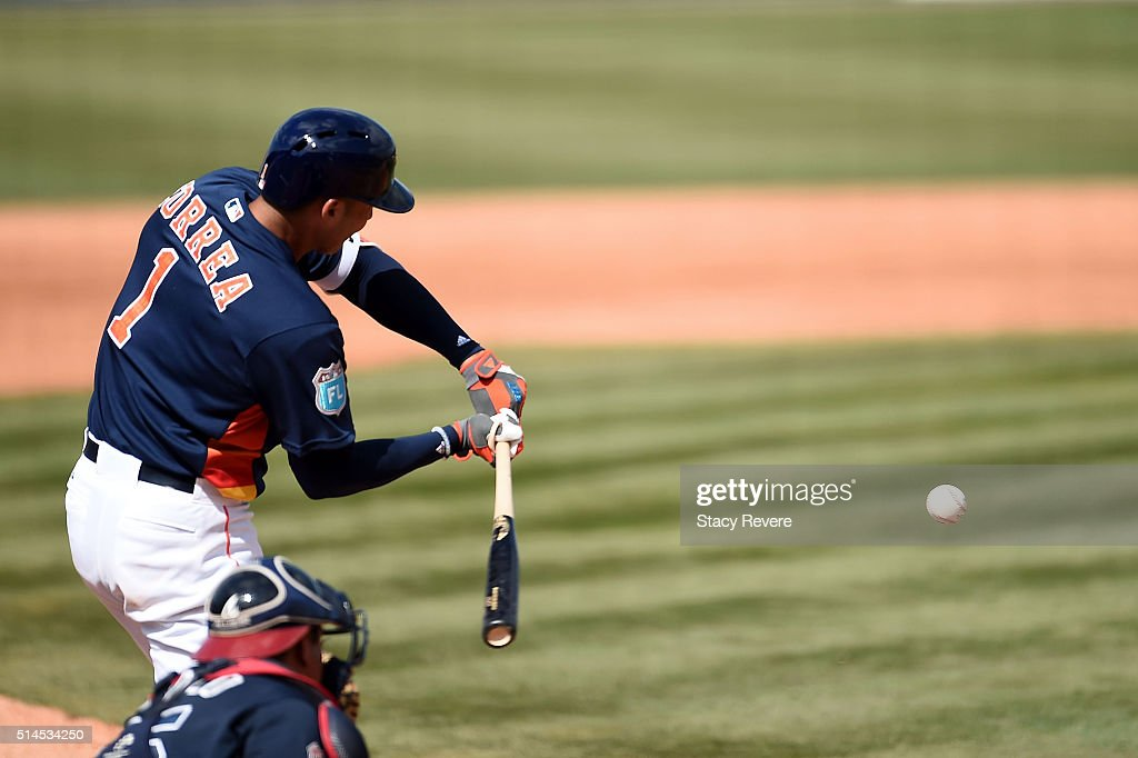 Carlos Correa #1 of the Houston Astros gets a base hit during the fourth inning of a spring training game against the Atlanta Braves at Osceola County Stadium on March 9, 2016 in Kissimmee, Florida.