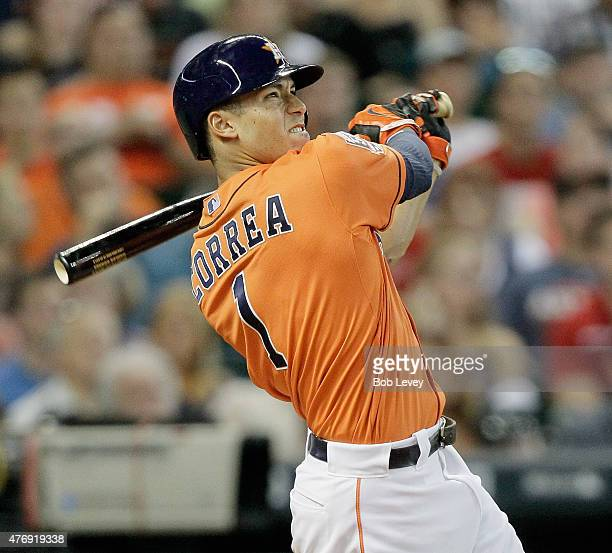 Carlos Correa of the Houston Astros hits a home run in the second inning against the Seattle Mariners at Minute Maid Park on June 12 2015 in Houston...
