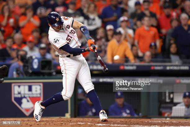 Carlos Correa of the Houston Astros hits a RBI double during the fourth inning against the Los Angeles Dodgers in game five of the 2017 World Series...