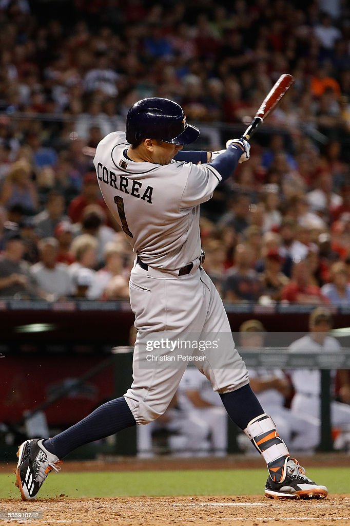 Carlos Correa #1 of the Houston Astros hits a RBI single against the Arizona Diamondbacks during the fourth inning of the MLB game at Chase Field on May 30, 2016 in Phoenix, Arizona.
