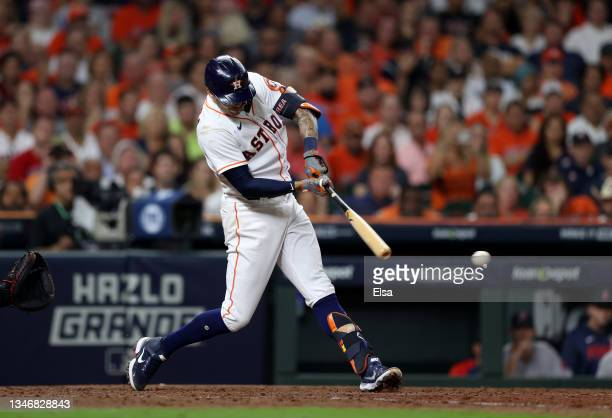 Carlos Correa of the Houston Astros hits a single in the fifth inning against the Boston Red Sox during Game One of the American League Championship...