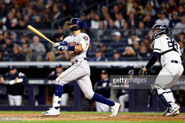 Carlos Correa of the Houston Astros hits a threerun home run against the New York Yankees during the sixth inning in game four of the American League...