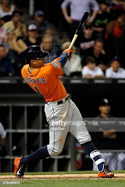 Carlos Correa of the Houston Astros hits a two run home run against the Chicago White Sox during the ninth inning his first home run in the Major...