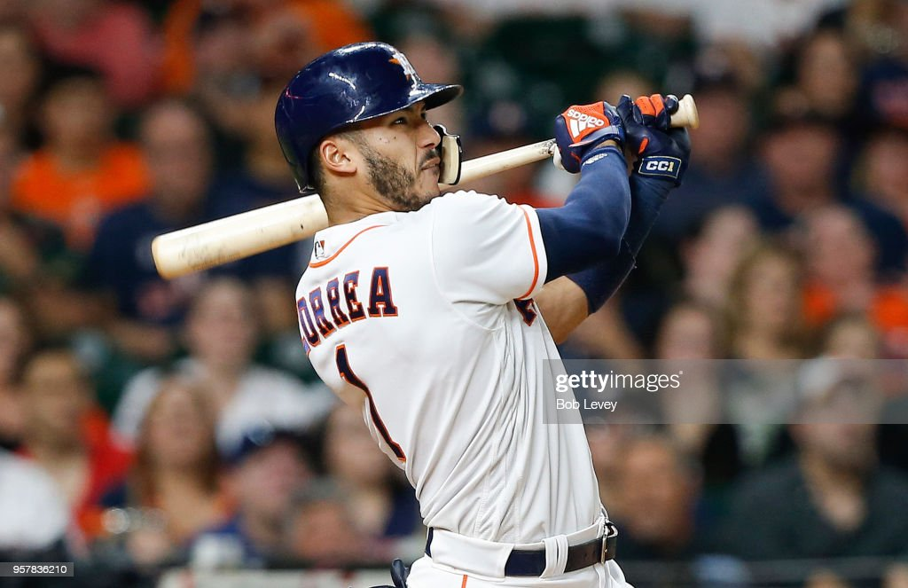 Carlos Correa #1 of the Houston Astros hits a two run home run in the eighth inning against the Texas Rangers at Minute Maid Park on May 12, 2018 in Houston, Texas.
