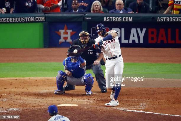 Carlos Correa of the Houston Astros hits a tworun home run during the seventh inning against the Los Angeles Dodgers in game five of the 2017 World...