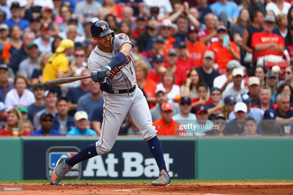 Carlos Correa #1 of the Houston Astros hits a two-run home run in the first inning against the Boston Red Sox during game three of the American League Division Series at Fenway Park on October 8, 2017 in Boston, Massachusetts.