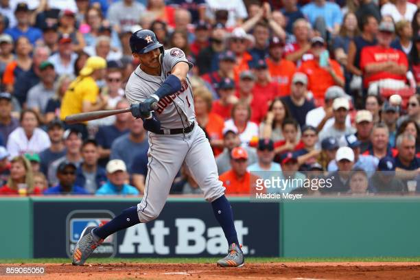 Carlos Correa of the Houston Astros hits a tworun home run in the first inning against the Boston Red Sox during game three of the American League...
