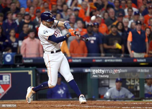 Carlos Correa of the Houston Astros hits a tworun home run in the seventh inning of Game 5 of the 2017 World Series against the Los Angeles Dodgers...