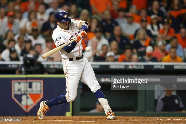 Carlos Correa of the Houston Astros hits a walkoff solo home run during the eleventh inning against the New York Yankees to win game two of the...