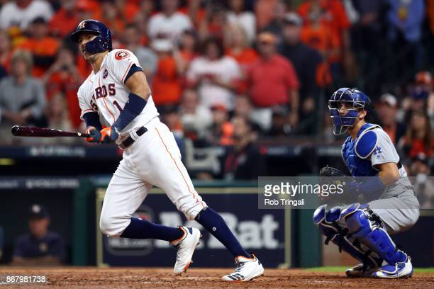Carlos Correa of the Houston Astros hits an RBI double in the fourth inning during Game 5 of the 2017 World Series against the Los Angeles Dodgers at...