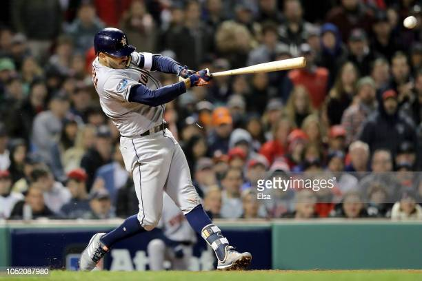 Carlos Correa of the Houston Astros hits an RBI single during the sixth inning against the Boston Red Sox in Game One of the American League...