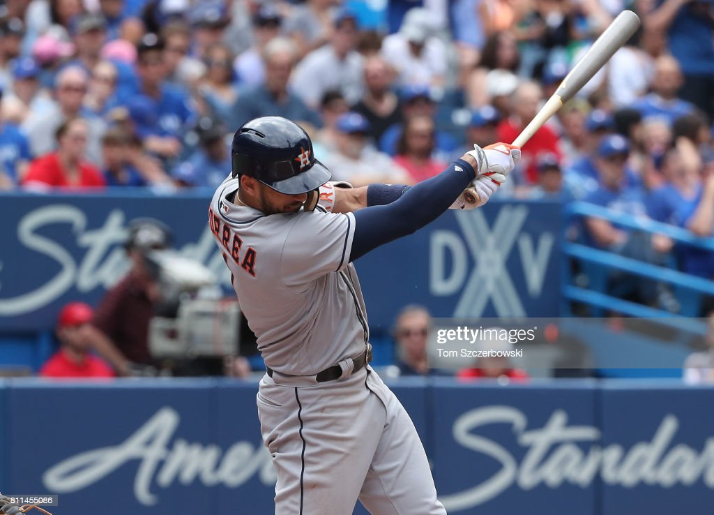 Carlos Correa #1 of the Houston Astros hits an RBI single in the fourth inning during MLB game action against the Toronto Blue Jays at Rogers Centre on July 9, 2017 in Toronto, Canada.