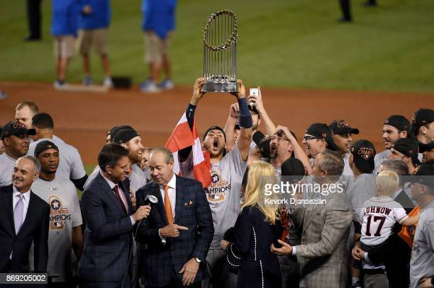 Carlos Correa of the Houston Astros hoists the Commissioner's Trophy after defeating the Los Angeles Dodgers 51 in game seven to win the 2017 World...