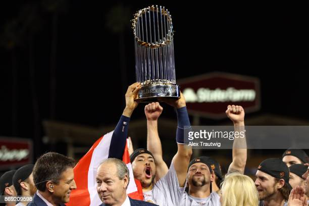 Carlos Correa of the Houston Astros hoists the Commissioner's Trophy after the Astros defeated the Los Angeles Dodgers in Game 7 of the 2017 World...