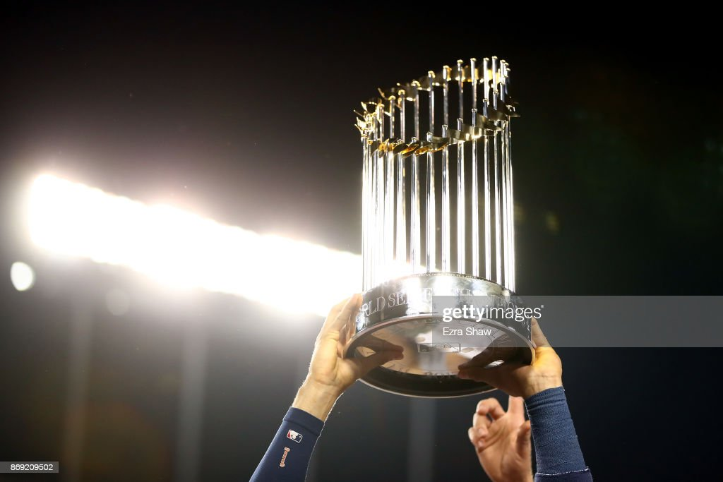 Carlos Correa #1 of the Houston Astros holds the Commissioner's Trophy after defeating the Los Angeles Dodgers 5-1 in game seven to win the 2017 World Series at Dodger Stadium on November 1, 2017 in Los Angeles, California.
