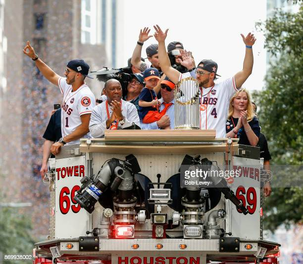 Carlos Correa of the Houston Astros Houston Mayor Sylvestor Turner Astros owner Jim Crane and George Springer with the champoionship trophy during...