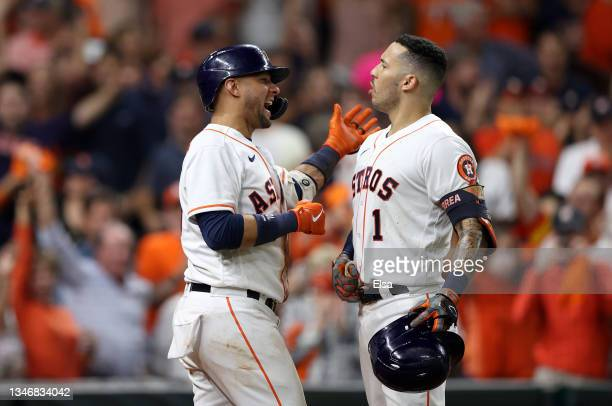 Carlos Correa of the Houston Astros is congratulated by Yuli Gurriel after hehit a home run in the seventh inning against the Boston Red Sox during...