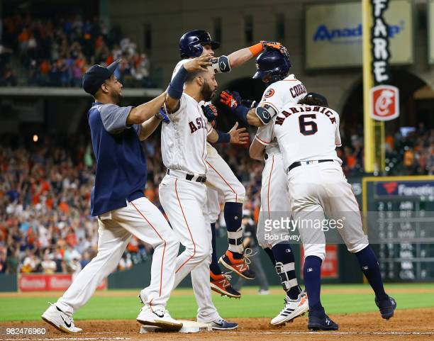 Carlos Correa of the Houston Astros is hugged by Jake Marisnick Josh ReddickMarwin Gonzalez and Yuli Gurriel after hitting a walkoff single in the...