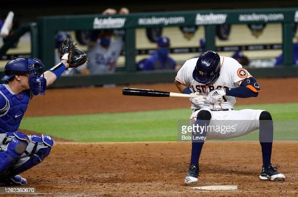 Carlos Correa of the Houston Astros is knocked down by a high inside pitch from Joe Kelly of the Los Angeles Dodgers in the sixth inning at Minute...