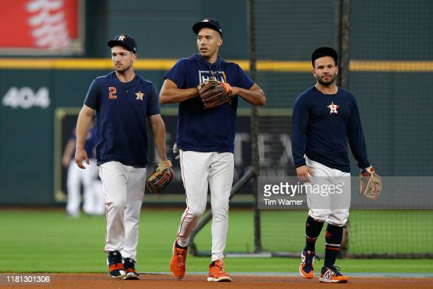 Carlos Correa of the Houston Astros Jose Altuve and Alex Bregman warm up before game five of the American League Divisional Series against the Tampa...