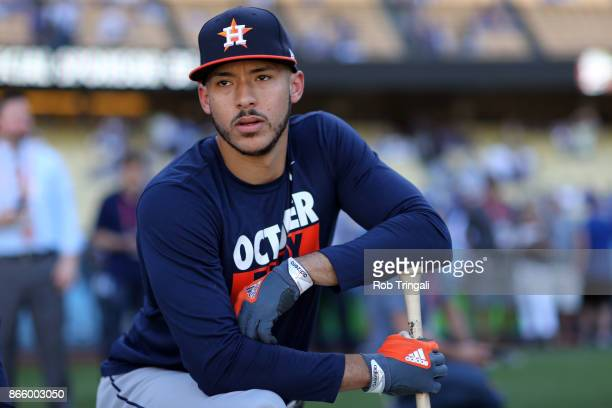 Carlos Correa of the Houston Astros looks on during batting practice prior to Game 1 of the 2017 World Series against the Los Angeles Dodgers at...