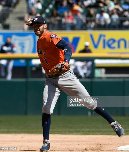 Carlos Correa of the Houston Astros makes a play against the Chicago White Sox on April 22 2018 at Guaranteed Rate Field in Chicago Illinois The...