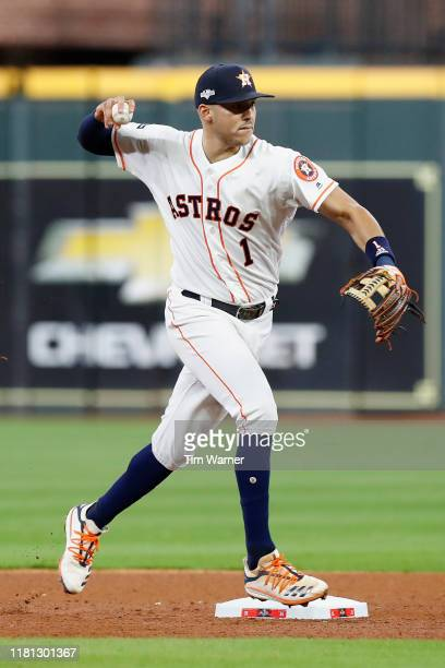 Carlos Correa of the Houston Astros makes a throw to first base for an out in the fifth inning against the Tampa Bay Rays during game five of the...