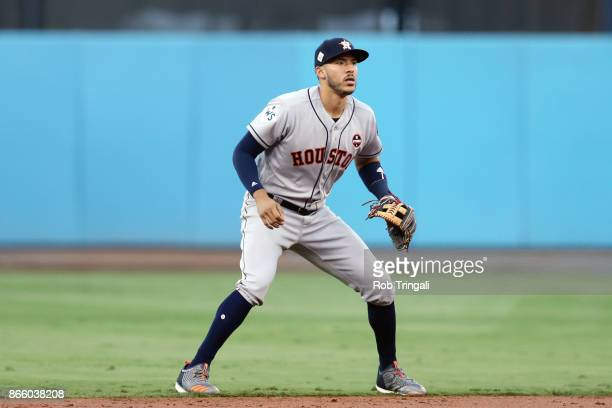 Carlos Correa of the Houston Astros plays defense at shortstop during Game 1 of the 2017 World Series against the Los Angeles Dodgers at Dodger...