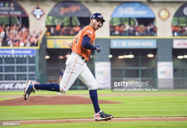 Carlos Correa of the Houston Astros reacts after a tworun home run against the Boston Red Sox in the first inning of game two of the American League...
