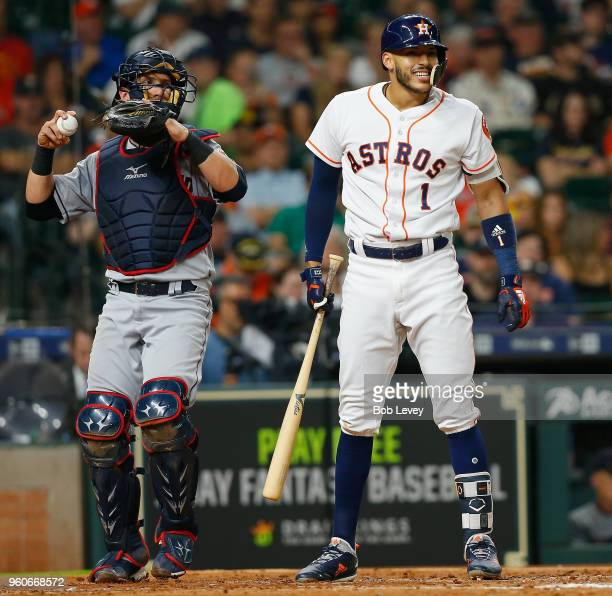 Carlos Correa of the Houston Astros reacts after being called out on strikes in the third inning as catcher Yan Gomes of the Cleveland Indians throws...