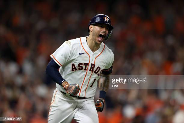 Carlos Correa of the Houston Astros reacts after he hit a home run in the seventh inning against the Boston Red Sox during Game One of the American...