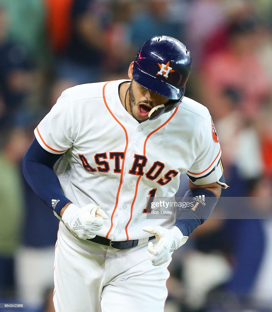 Carlos Correa #1 of the Houston Astros reacts after hitting a home run in the eighth inning against the New York Yankees at Minute Maid Park on May 3, 2018 in Houston, Texas.