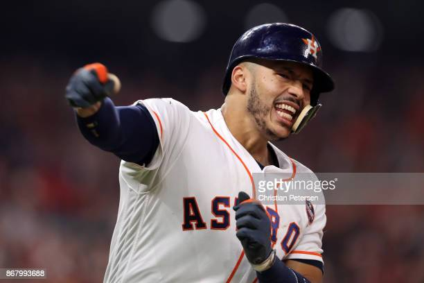 Carlos Correa of the Houston Astros reacts after hitting a tworun home run during the seventh inning against the Los Angeles Dodgers in game five of...