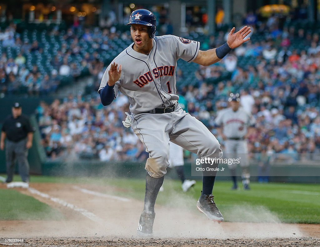 Carlos Correa #1 of the Houston Astros reacts after scoring on a wild pitch in the fifth inning against the Seattle Mariners at Safeco Field on July 15, 2016 in Seattle, Washington.